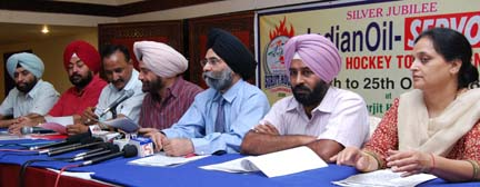 Jalandhar Deputy Commissioner Ajeet Singh Pannu addressing a press conference in Jalandhar on Monday. Also seen in picture is Olympian Pargat Singh (second from right).