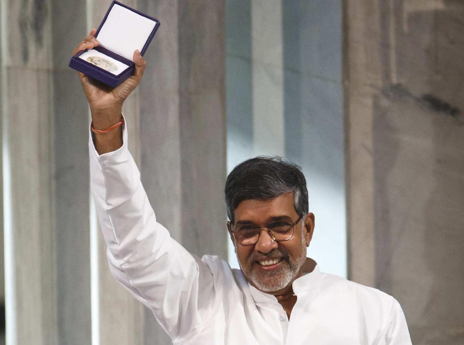 Nobel Peace Prize laureates Yousafzai and Satyarthi pose with their medals during the Nobel Peace Prize awards ceremony at the City Hall in Oslo