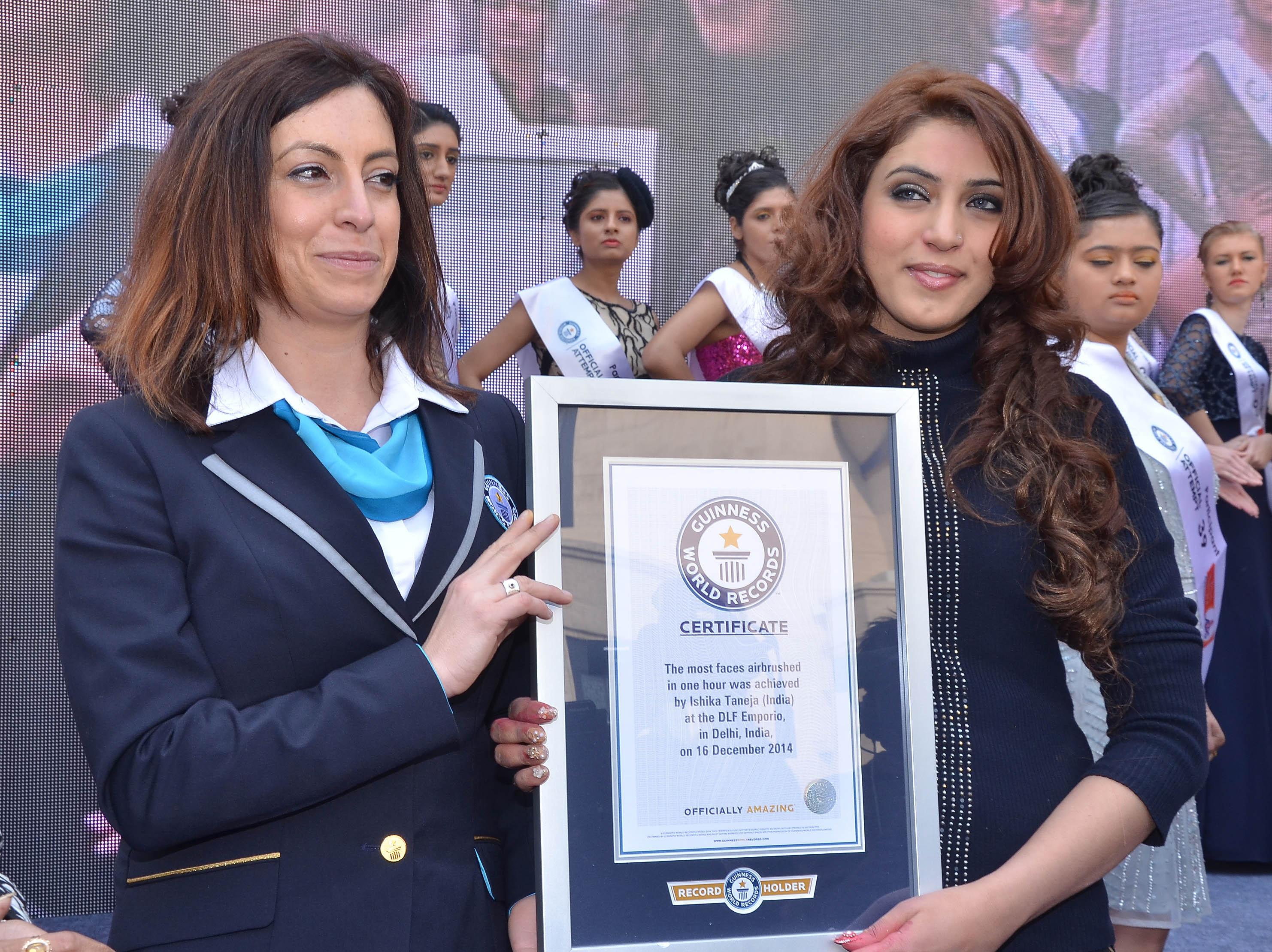 Ms Lucia Sinigagliesi, Guinness World Record official adjudicator presenting Guinness World Record award to Ishika Taneja in Capital