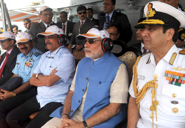 The Prime Minister, Shri Narendra Modi witnessing the Naval show- Air show aboard INS Vikramaditya, on December 15, 2015. The Union Minister for Defence, Shri Manohar Parrikar, the Chief of Naval Staff, Admiral R.K. Dhowan and the Chief of the Air Staff, Air Chief Marshal Arup Raha are also seen.