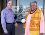 Rajan Zed (right) before breaking the coconut to formally inaugurate Unity Church of Today in Nevada's capital Carson City in USA. Rev. Larry Schneider, Minister of the Church, is at left.