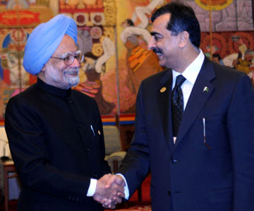 The Prime Minister of Pakistan, Mr. Yousuf Raza Gilani meeting the Prime Minister, Dr. Manmohan Singh, on the sideline of 7th ASEM Summit, in Beijing, China on October 24, 2008.
