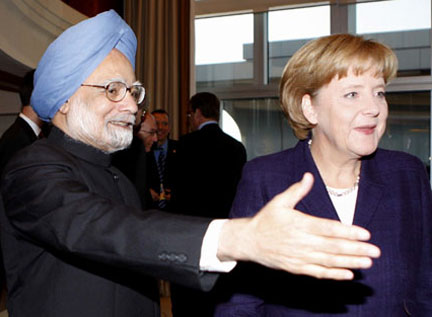 The Prime Minister, Dr. Manmohan Singh with the German Chancellor, Ms. Angela Merkel at a breakfast meeting on the sideline of 7th ASEM Summit in Beijing, China on October 25, 2008.