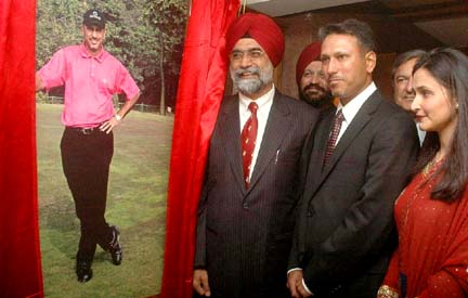 Golf icon Jeev Milkha Singh unveiling his portrait at the Chandigarh Golf Club on Saturday his wife is also seen in the photo.