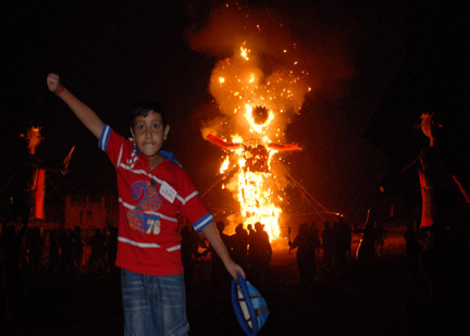 A young boy in jubiliant mood after burn the Ravana effigy to mark Dussehra festival in Chandigarh. Photo by Jagdish Kandpal