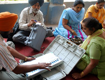 Poll officials check EVMs at a distribution centre before leaving for polling stations, on the eve of the final phase of Lok Sabha polls in Amritsar on Tuesday. PHOTO-PRABHJOT GILL AMRITSAR